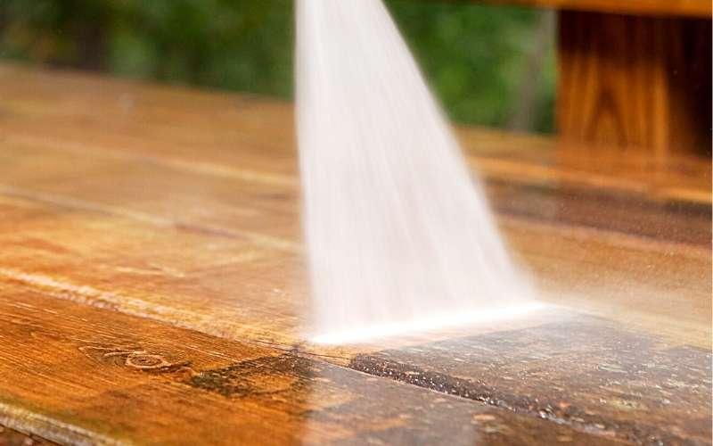 directing spray on wooden decking