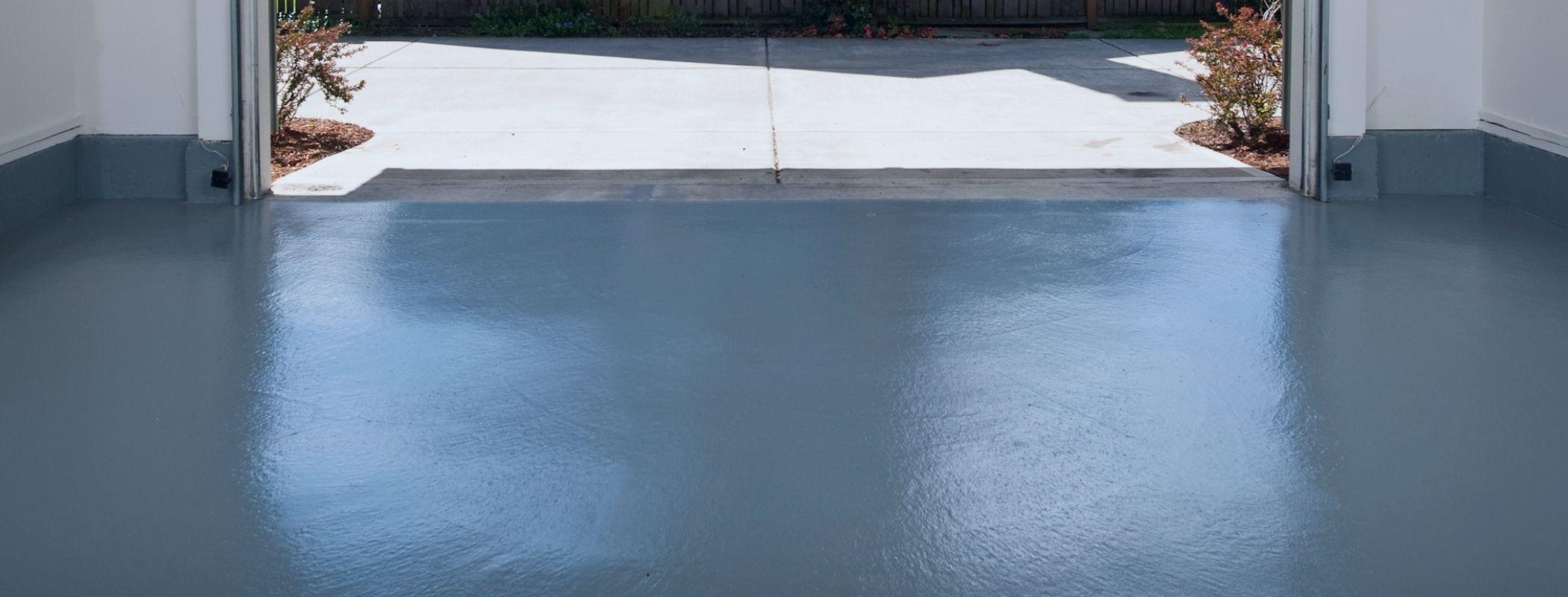 garage floor cleanin gwith pressure washer