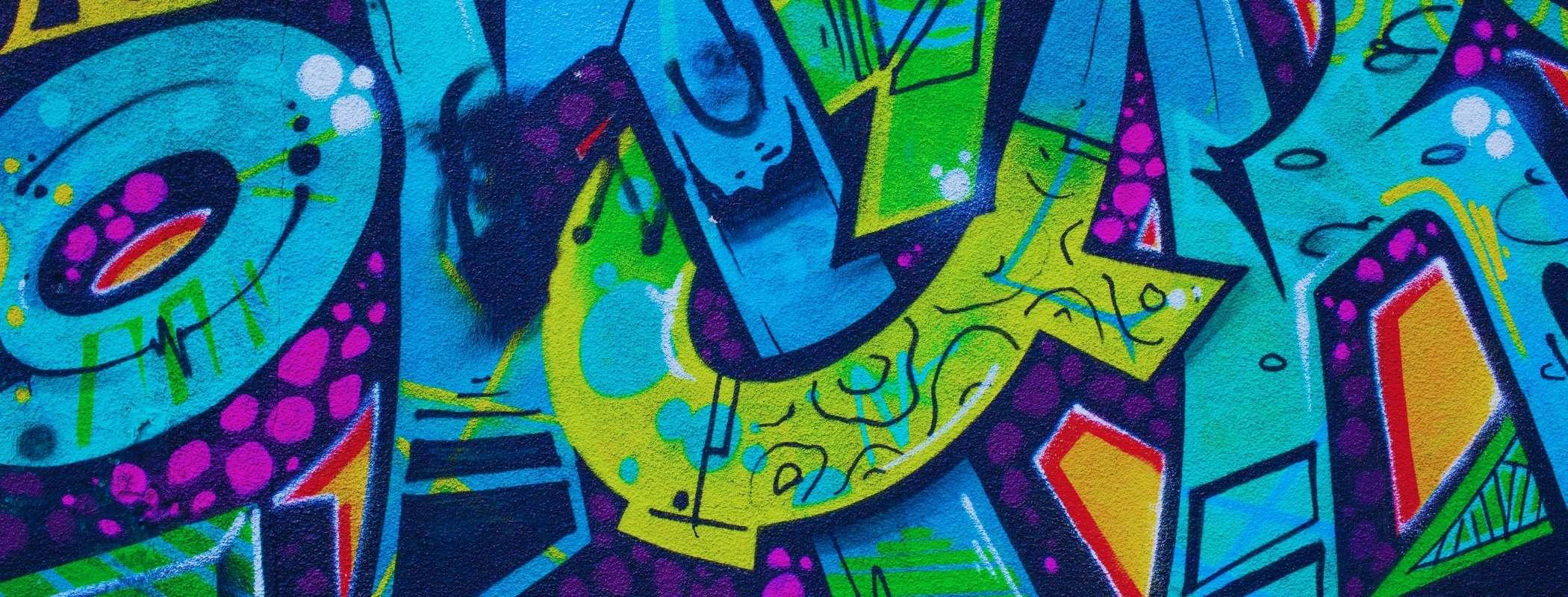 removing graffiti with pressure washer